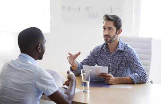 open office, two men are having a meeting