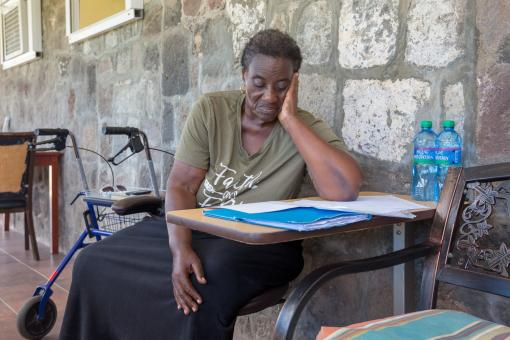 Dutch Caribbean woman is reading a letter