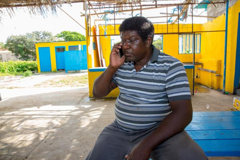 Man in Dutch Caribbean is having a phonecall